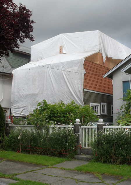 Original House Tarped for Floor Addition